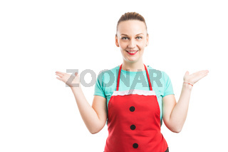 Young maid or housewife holding copy space