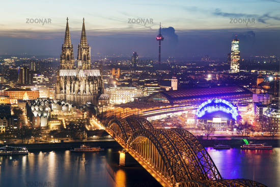 cityscape of Cologne with cathedral and brigde over Rhine at sunset, Cologne, Germany, Europe