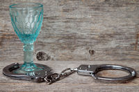 Alcoholism concept,glass with handcuffs
