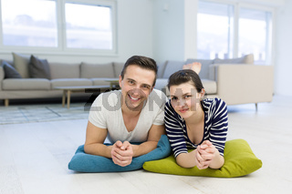 couple lying on the floor at home