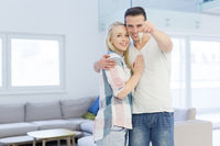 couple showing a keys of their new house