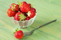 Fresh organic strawberries and a fork