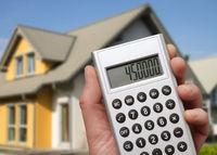 Modern house and calculator