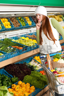 Grocery store shopping - Red hair woman in winter outfit