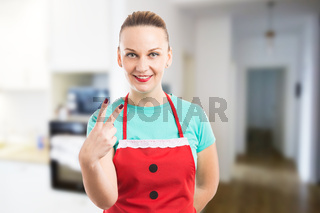 Housekeeper or maid showing number two with fingers
