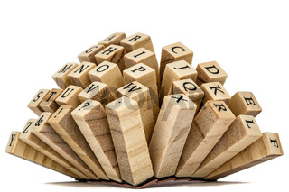 Letters of the English alphabet on the ends of wooden bars, isolated on white background
