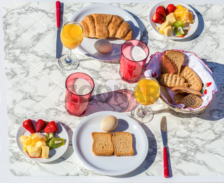Set table with food and drink for breakfast