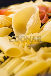 Collection of different Italian pasta as closeup on wood