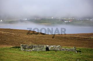 Rural area in morning fog on Unst Island, Shetland Islands, Scotland