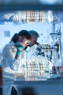 Health care researchers working in scientific laboratory.
