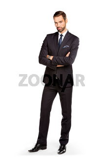 Handsome young businessman standing confident. Isolated on white