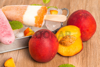 Homemade raspberries and peach popsicles