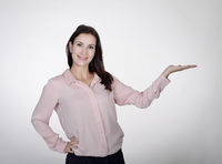 businesswoman presenting with one hand