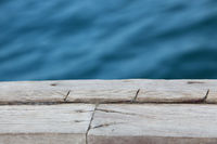 Closeup Of An Old Wooden Pier Over The Water