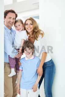 Happy family in doorway