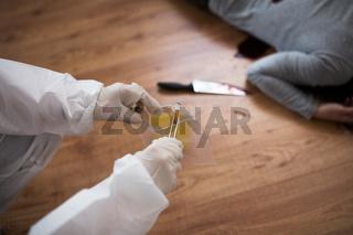 criminalist collecting crime scene evidence