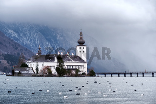 Monastery on the island of alpine lake in Gmunden by Salzburg, Austria