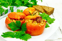 Tomatoes stuffed with bulgur and parsley in plate on board