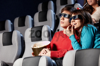 The couple with pop-corn looks cinema in 3d