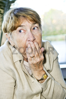 Scared elderly woman