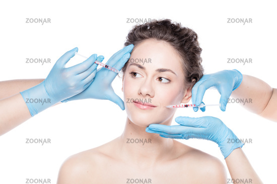 Young woman having botox face injections.