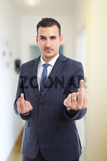 Lawyer showing middle fingers indoors in apartment lobby