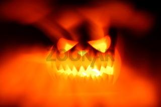 Halloween pumpkin shiny inside on black