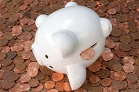 Piggy bank on pile of copper coins