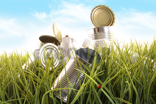 Forgotten empty cans and bottles in grass