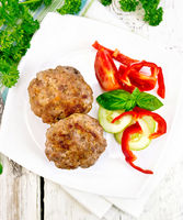 Cutlets stuffed with basil in plate on board top