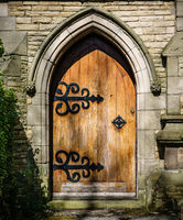 Arched Stone Doorway with Closed Wooden Door