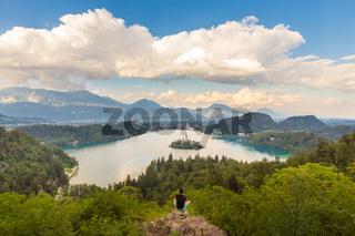 Man enjoying panoramic view of Lake Bled, Slovenia.