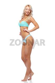 happy smiling young woman in bikini swimsuit