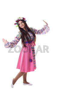 young girl with garland dance in russian costume