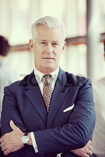 portrait of handsome senior business man at modern office