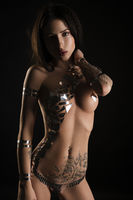 Nude woman her body covered with gold tape bodyart