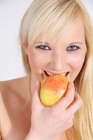 young woman eating an apple