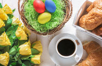 Easter breakfast table and roses bouquet