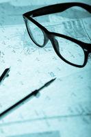 surveyor's plan, circle and retro glasses with bac