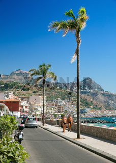 The main tourist promenade of Giardini Naxos on the island of Sicily Italy
