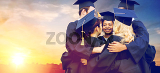 happy students or bachelors hugging