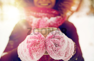 close up of woman with tea mug outdoors in winter