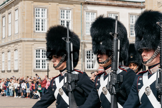Soldiers of the Danish Royal Life Guards for the changing of the guards on the central plaza of Amalienborg palace in Copenhagen