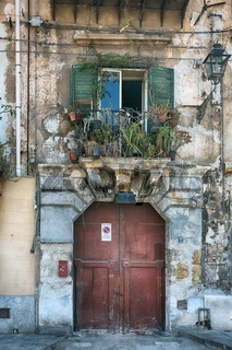 vintage balcony with different flowers