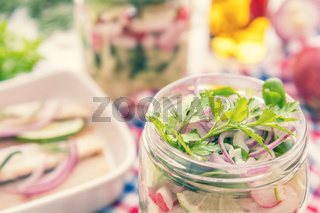 Salads with vegetables and sliced herring fillets