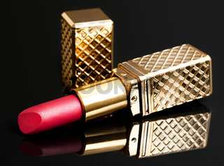 red lipstick on black background
