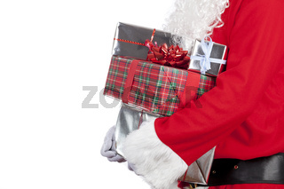 Farther christmas carrying a pile of wrapped christmas presents on a pure white background