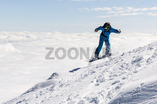 Freestyle snowboarder in the mountain