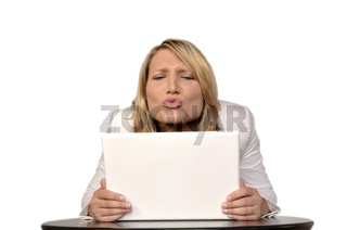 Blond Woman Looking At A White Laptop