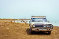 Old Volga car and oil rig